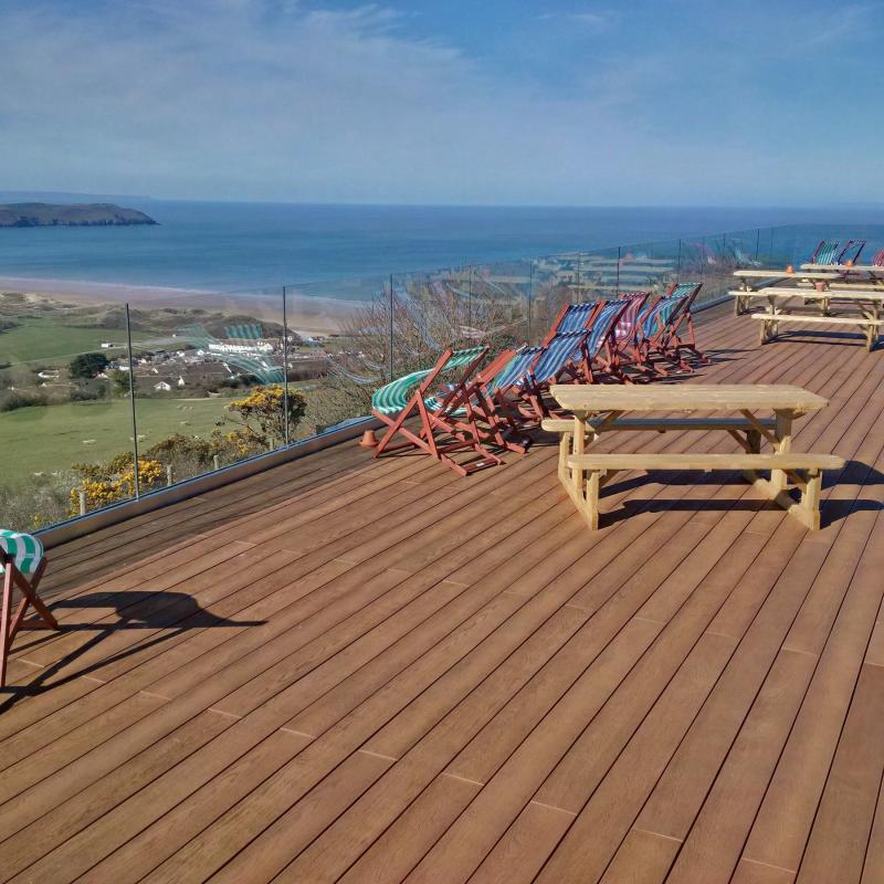 Millboard Coppered Oak decking at beautiful Woolacombe Bay