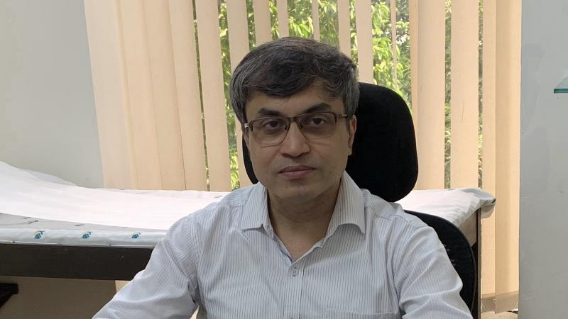 Dr. Srinjoy Saha in his chamber in Kolkata, India.
