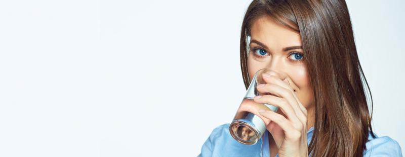 Lady drinking clean filtered water