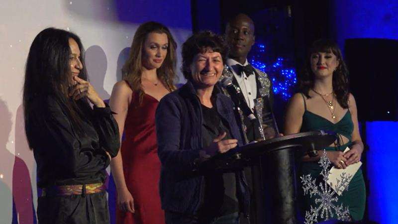 Diana Zuros accepts the award for Best Picture