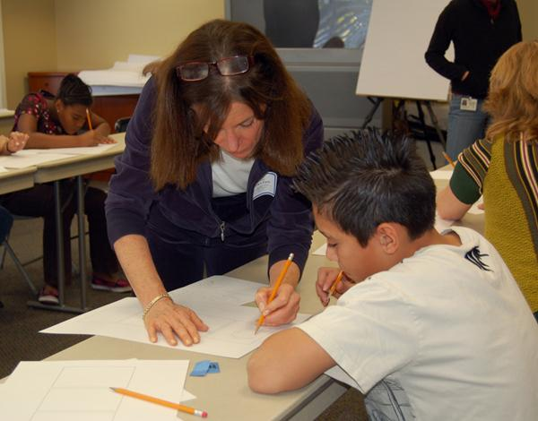 Cathy Guisewite teaches student at Hillsides Education Center to create cartoon