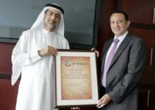 Mr. Mohammed Sharaf, CEO, DP World presenting the '3 x 3' Award to Mr. Nader Atout, Managing Director – Gulf Region, Dimension Data