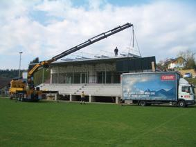 The mounting of the collectors on the roof of the sports club in cooperation with the TiSUN crane installation team and the local plumber