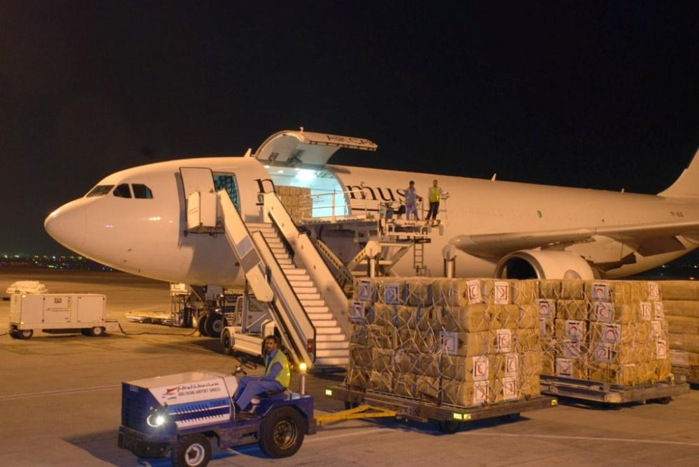 loading of the UAE Red Cresecent relief supplies Maximus A300-600RF in Abu Dhabi bound for Chengu, PRC