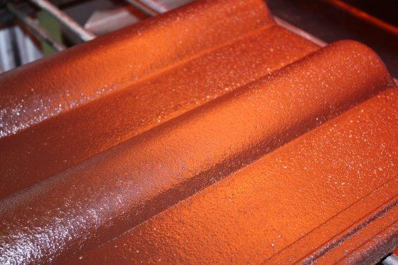 Infrared heat dries protective coating on roof tiles