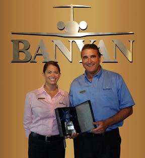 On behalf of the Banyan team, Andrea Bahr, customer support manager, and John Mason, director of FBO services, accept the Pilots'