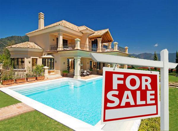 Spain cuts new property tax in half to lift Spanish real estate industry