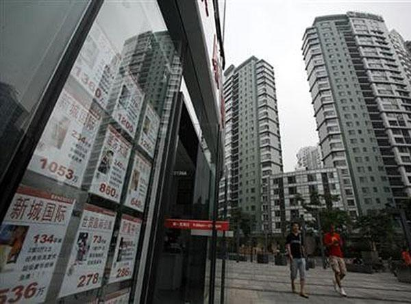 China bans overseas investment in villa projects
