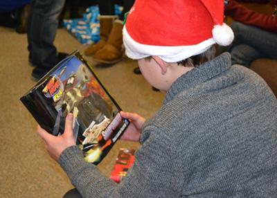 Hillsides resident opening a christmas gift delivered by Santa