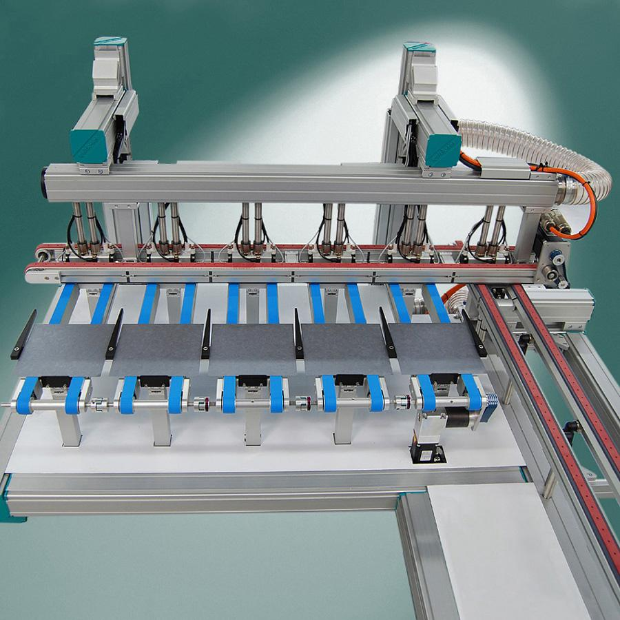 The vacuum conveyor can carry parts from many to one track and from one to many